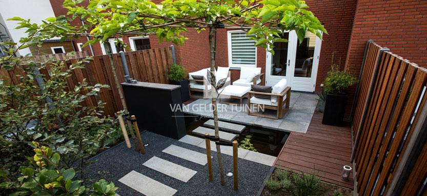 kleine tuin met vijver bij nieuwbouwwoning van gelder tuinen
